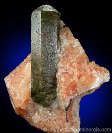 Elongated Apatite in Orange Calcite