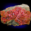 Dense Realgar Crystals Covering Matrix