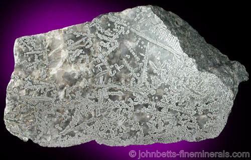 Silver in sliced Calcite Matrix