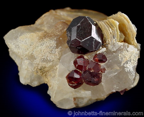 Spessartine Crystals on Quartz