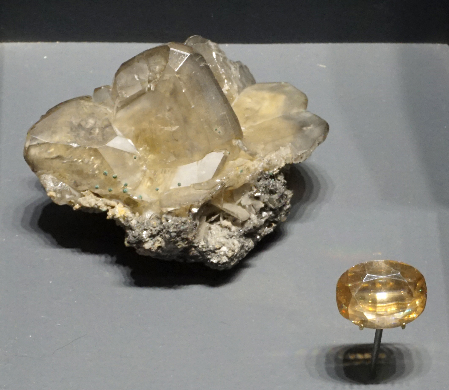 Light Colored Wulfenite and Cut Gemstone